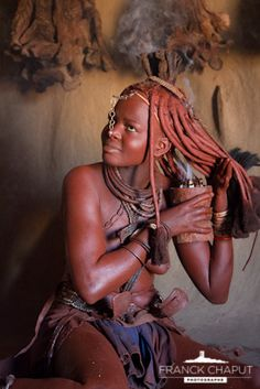 Himba woman fuming her body with Myrrh.  The Himba are indigenous peoples with an estimated population of about 50,000 people living in northern Namibia, in the Kunene region (formerly Kaokoland) and on the other side of the Kunene River in Angola.