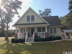 View listing details, photos and virtual tour of the Home for Sale at 107 Joclar Lane, Manteo, NC at HomesAndLand.com.