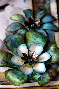 "These flowers are createdusing Tim Holtz Alterations ""Tattered Florals"" die -cut."