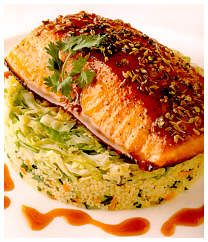 Roasted Salmon with Moroccan Barbecue Sauce, Couscous, and Sauteed Savoy Cabbage by Charlie Trotter.