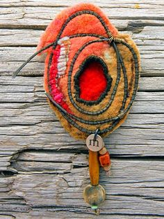 "Felted brooch by Gail Perrone. ""In my current work, I've been exploring material combinations - as in recent pieces with paper fibers, felt and metal."""