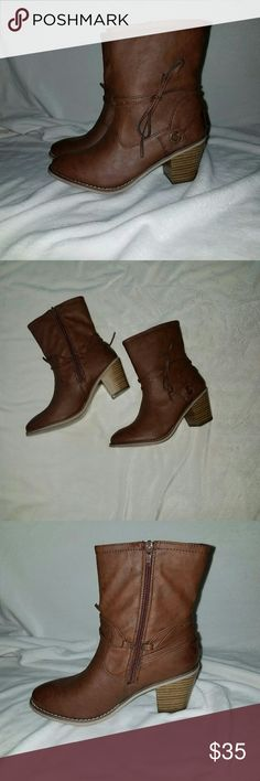Brown Vegan Leather Bootie *NWT, Never Worn* Brown Vegan Leather Bootie features a wraparound tie threaded through a bronze grommet.  Round toe.  Stacked heel.  Height from floor to top of boot is approx. 9.5?.  Approx. 3? heel height.  No platform.  Calf circumference approx. 12.5?.  Functional zipper on inner side approx. 7.5?.  Size 9. JustFab Shoes Ankle Boots & Booties