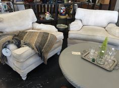 Check out this beautiful pair of cream colored chenille upholstered chairs. They look great with the coffee table in French Linen.