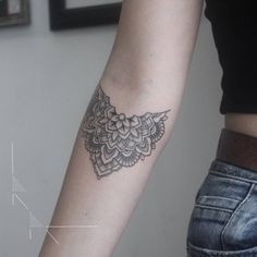 Floral mandala tattoo on Anyas right inner forearm....