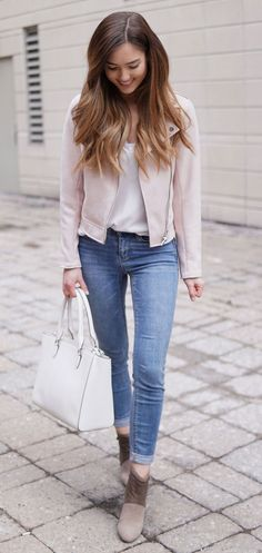 The perfect transitional outfit for spring. This suede jacket comes in blush pink and dusty grey and is so soft and comfortable! Paired with a white tote and some light wash skinny jeans. #fashion #outfit #style #springstyle #springoutfit #fashionblog Marie's Bazaar