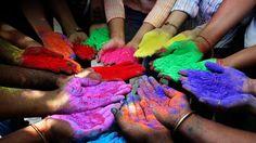 powder paints to celebrate Holi on Festival of Colors India Colors Powder on Hands of Holi Celebration Ahmedabad India