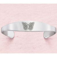 """Stainless Steel Free to Fly Cuff Bracelet This little butterfly has a lesson to teach, inscribed inside the stainless-steel bracelet she adorns: """"Just when the caterpillar thought the world was over, She became a butterfly."""" Hypoallergenic. Bends to fit."""