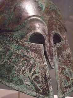 Corinthian-style Etruscan helmet incised with images of boars Bronze 5th century BCE (1)