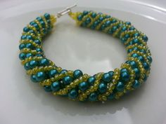Teal and Yellow Russian Spiral Bracelet by tahdeah on Etsy, $10.00