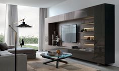 Lovely underlit shelves add elegance to the gorgeous wall unit system