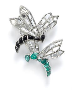 A platinum and gem-set brooch in the form of hovering mayflies by Van Cleef and Arpels, their wings represented with diamonds calibré-cut specifically for each individual openwork mount, their bodies set with emeralds and onyx respectively. Paris, c.1925.