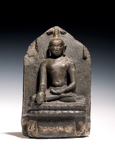 2. An inscribed Stele with a seated Buddha  India, Bihar Pala period, circa 10th Century AD  Phyllite H 17.5 cm