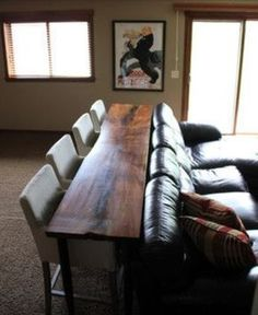 I like this idea for the basement, instead of having a coffee table -- lets the kids watch TV while they're eating, but keeps the crumbs off the couch.