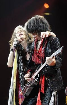 Steven Tyler, left, and Joe Perry of Aerosmith performs at the American Airlines Center on Saturday, July 28, 2012.