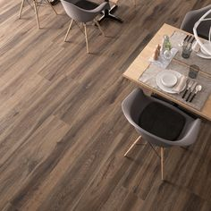 Discover the Barkwood porcelain stoneware inspired by wood. Ideal for domestic and commercial large spaces. Minimalism, Dining Table, House Design, Furniture, Home Decor, Villa, Timber Flooring, Houses, Decoration Home