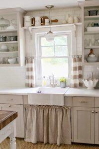 4 fregadero bajo ventana cocina blanca y tostado