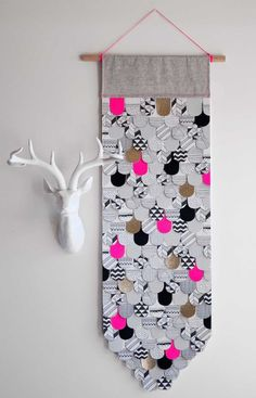 Laura Blythman // Paper Feather Wall Hanging