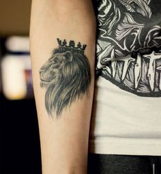 Lion face tattoo with crown on head - Tattooimages.biz