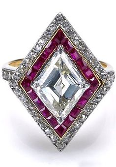 An art deco diamond and ruby ring, Tivol, circa 1915 centering one kite-shape diamond surrounded by rows of calibré-cut rubies and old single-cut diamonds; signed C.L.Tivol & Sons for Tivol, Kansas City; central diamond weighing approximately: 2.05 carats; mounted in platinum-topped fourteen karat gold; size: 5 1/4