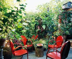 Scale It Down  Patio furniture can quickly eat up a small deck or patio. Keep your outdoor living accessories on the small side to make the most of your space. However, don't be afraid to use color to make an impact and keep them from feeing too tiny. Here, the startling red chairs helps distract from their small, simple design.
