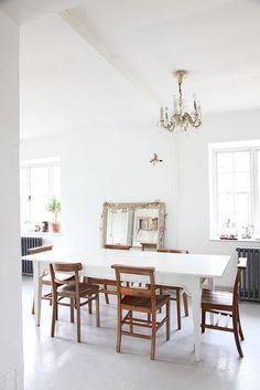 Modern Country Inspired Dining Room with Mixed and Matched Chairs