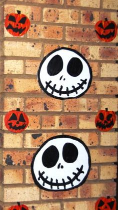The Jack Skellington Bday Party: Cardboard cut-outs of JS faces and pumpkins