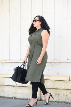 Tanesha Awasthi, also known as Girl With Curves, wearing a plus size shirtdress…