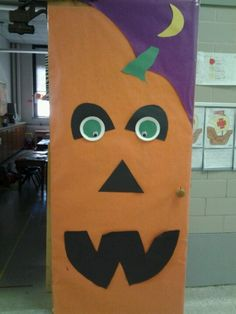 Great pumpkin door decoration!!! School Door DecorationsBy HalloweenHalloween ... & cute...and may work with all sorts of blackout shapes you would ...