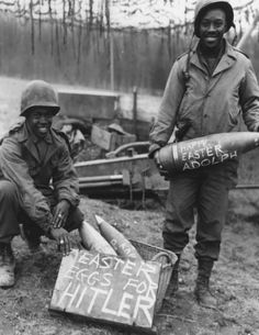 """Two American Soldiers proudly show off their personalized """"Easter eggs"""" (155mm artillery shells) before firing them. - Easter Eggs for Hitler Photo by National Archives"""