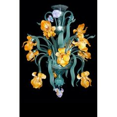Van Gogh Iris chandelier belongs to a prestigious line dedicated to the impressionism, which combines Murano glass with classic and nature art. Details are refined with such care they donate to the chandelier a unique grace. Van Gogh Iris is made up of 24 lights set into flowers and it's decorated with leaves, blossoms and pendants realized with the finest glass. Visit our website to see or buy online our products! www.sognidicristallo.it