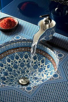 Gorgeous Moroccan Pottery Sink. Found some that ship to the UK here: http://www.coloursmorocco.com/category/moroccan-vessel-sinks More