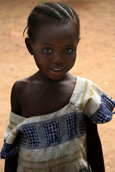 African girl. Something about her smile.