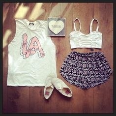 Brandy melville outfit-white LA muscle tank,white bralette top,black printed shorts,white sneakers.