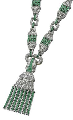 An Art Deco emerald and diamond sautoir, 1930s. Designed as a series of pierced geometric plaques alternating with rectangular spacers, set with single-cut diamonds and calibré-cut emeralds, suspending to the front a tassel set with similar stones, together with brilliant- and circular-cut diamonds. Converts to a shorter necklace or as three bracelets. French assay and maker's marks. #ArtDeco #sautoir #necklace