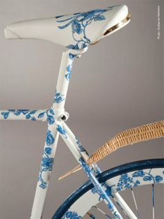 Hand painted white and blue bicycle with wicker instead of chrome.