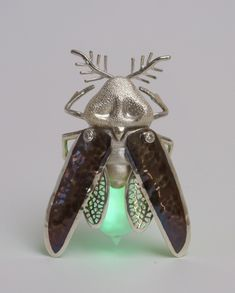 Illumination, 2010, Sterling Silver, Liver of Sulfur, Moissanite Synthetic Diamonds, Light Bulb, Glowsticks, 8.5cm x 6cm x 3cm. Photo credit: Justin Poulsen.