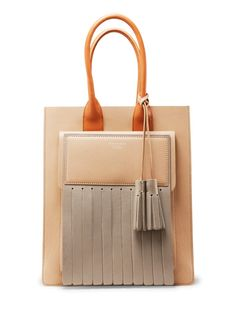 Leather fringe! the Piers Beige Mix s a fringed leather shopper with a front compartment. via Acne