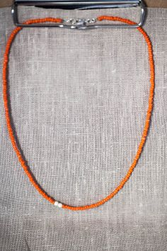 Orange glass bead necklace