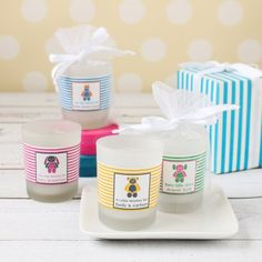 Light up the room with these adorable themed personalized frosted glass votive baby shower candle favors.