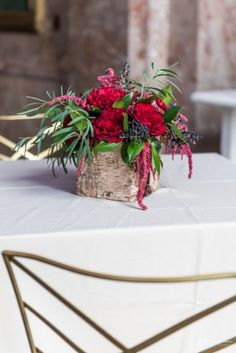 red roses centerpiece by winston salem florist, Eliana Nunes Floral Design. Venue: Millennium Center Winston Salem NC | image by J Hampden Visuals