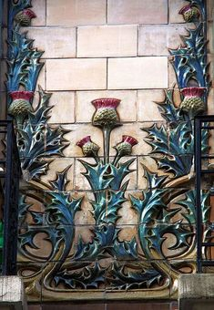 Hector Art Nouveau interior | Art Nouveau ceramic details (thistles) in Paris 16th | JV: