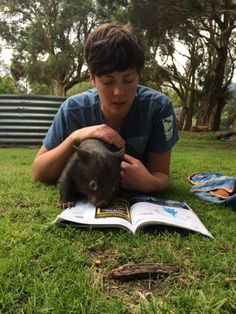 Keeper Amie has been enjoying the spring sunshine with this gorgeous baby wombat at Healesville Sanctuary | www.zoo.org.au Photo credit: Keeper Julie