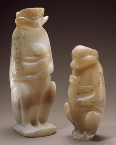 Two Vases for storing perfumed oils in the Shape of a Mother Monkey with Her Young, Egyptian. Reign of Merenre, Old Kingdom, 2255-2246 BCE. Egyptian alabaster, one inscribed with the name of Merenre, one with the name of his father, Pepi I.