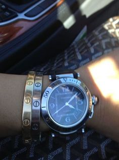 bangles and cartier love bracelets not the watch, not crazy about that at all.