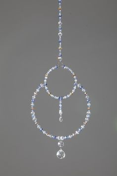 Large double circle hanging crystal beaded suncatcher with crystal prisms & crystal octagon. by ElementalRoseDesigns on Etsy Wire Crafts, Bead Crafts, Jewelry Crafts, Wire Jewelry Designs, Jewelry Patterns, Wire Wrapped Jewelry, Beaded Jewelry, Diy Wind Chimes, Crystal Wind Chimes