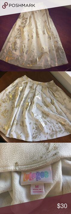 Lularoe NWOT Elegant Collection Madison (M) Part of Lularoe's limited edition Elegant Collection. Size medium. A cream color with splashes of gold. And POCKETS?! Yes! Beautiful for date night, business dinners or other special occasions LuLaRoe Skirts Midi