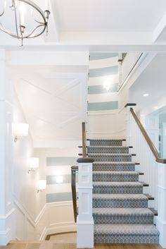 Striped accent in stair wells of Utah home designed by Lindy Allen of Four Chairs Furniture. Photo by Jessie Alexis Photography (via House of Turquoise). Stairway Walls, Entry Stairs, House Stairs, Carpet Stairs, Coastal Homes, Coastal Living, Stair Well, House Of Turquoise, Wall Treatments