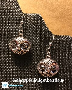 Handmade silver owl dangle earrings. Check out my FaceBook page at www.facebook.com/ahopperdesignsboutique