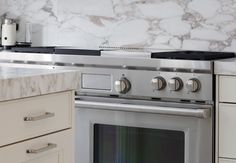 Ormonde Gate Kitchen Design  Thurloe White Bespoke Cabinetry - 50mm thick Arabescato Oro Vagli Marble & backsplash - Wolf Range cooker