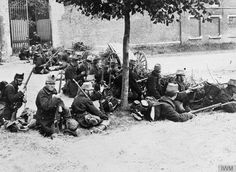 """Belgian soldiers sit behind a barricade armed with rifles in a street in Louvain (Leuven) during the retreat to Antwerp"", 20th August 1914 [800 × 585]"